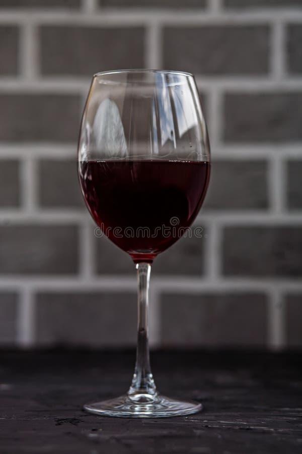 Um vidro do vinho vermelho Conceito das bebidas fotos de stock