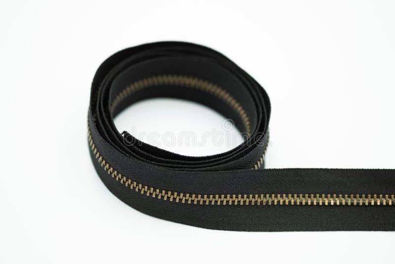 Um zíper do metal na cor marrom fotografia de stock royalty free
