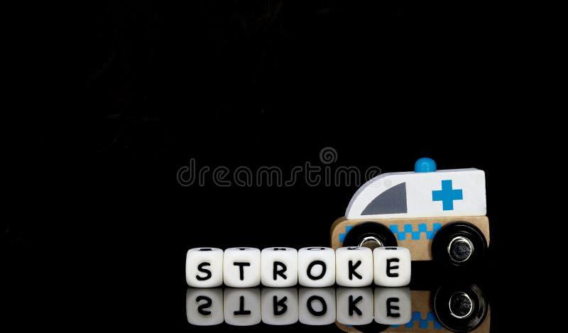 uma ambulância do brinquedo e um curso da palavra imagem de stock