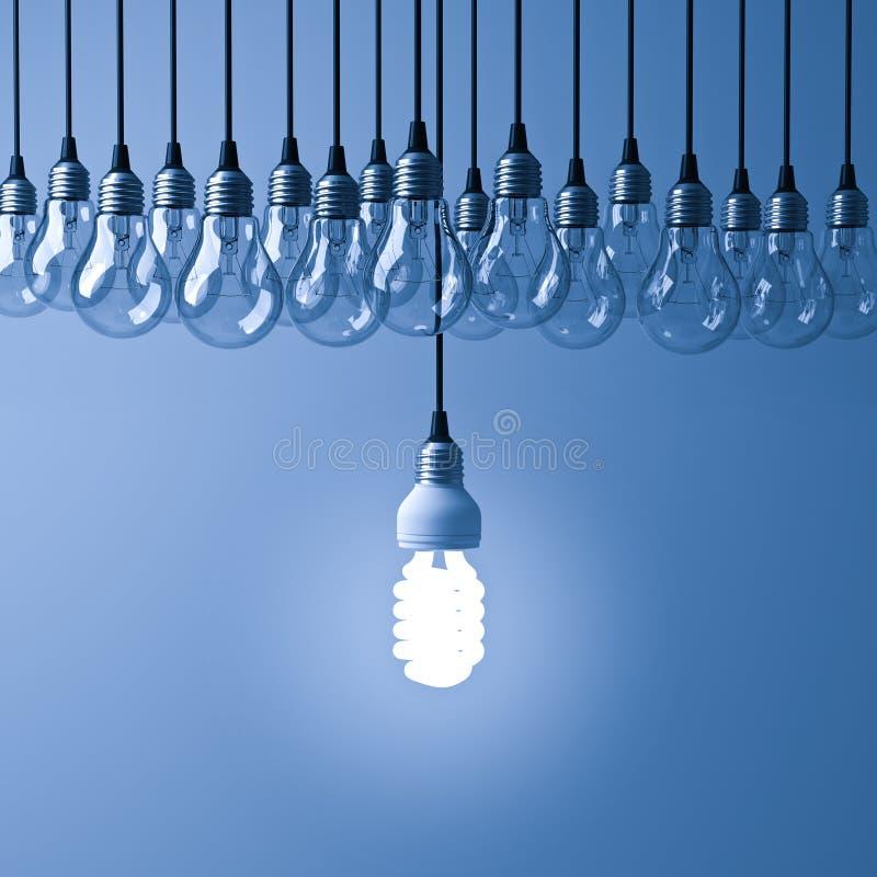 Uma ampola de poupança de energia de suspensão do eco que incandesce e que está para fora dos bulbos incandescentes unlit na obsc fotos de stock