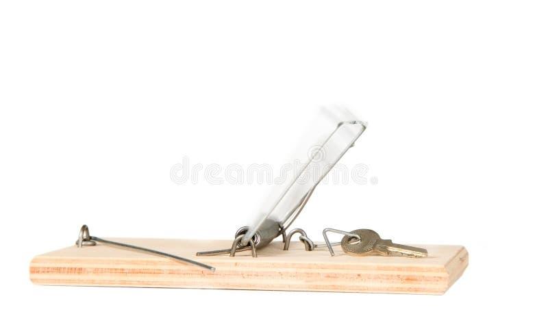 Uma armadilha do rato com chaves imagens de stock