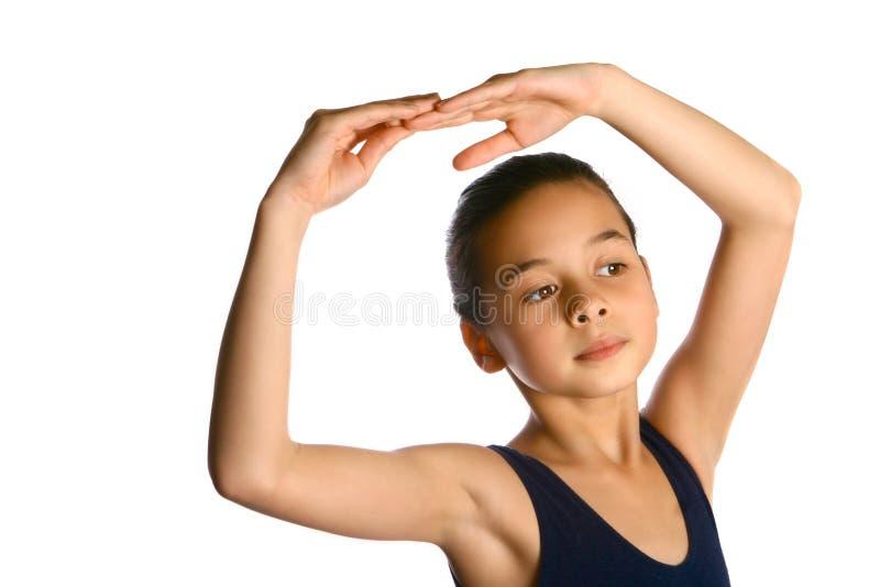 Uma bailarina nova que aprecia seu bailado fotografia de stock