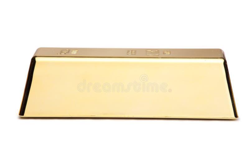 Uma barra de ouro fotografia de stock royalty free