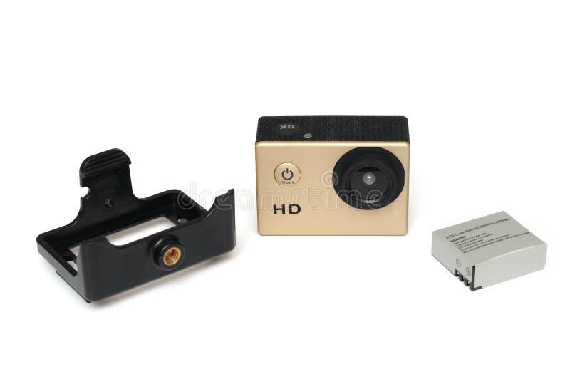 Uma câmara de vídeo alta pequena da ação da definição HD com o suporte da montagem da bateria e de tripé imagens de stock