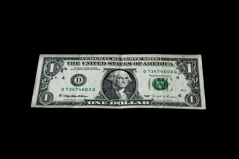Uma cédula do dólar isolada no preto para o negócio e a finança imagens de stock royalty free