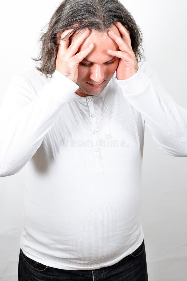 Uma cabeça de dor do homem fotografia de stock royalty free