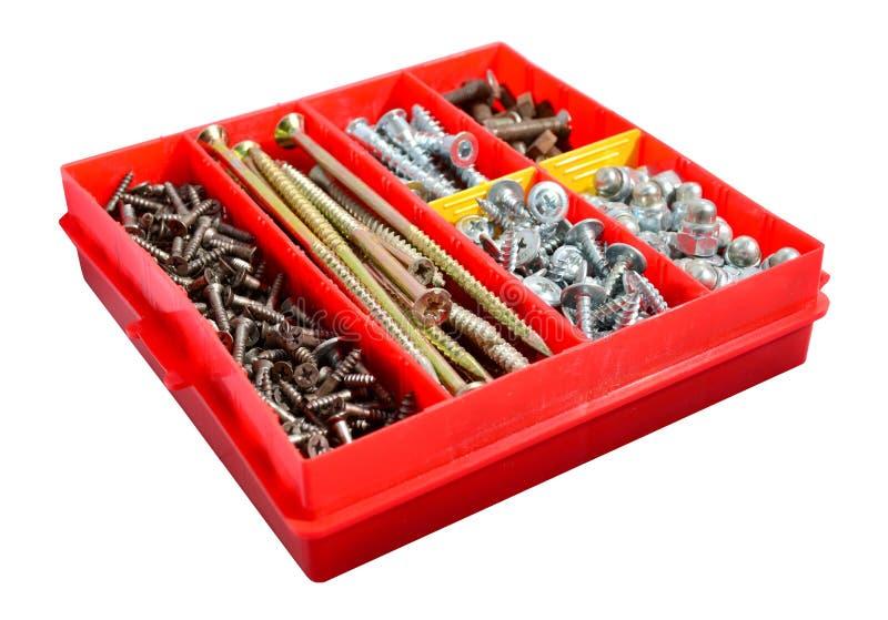 Uma caixa dos parafusos e dos parafusos imagem de stock