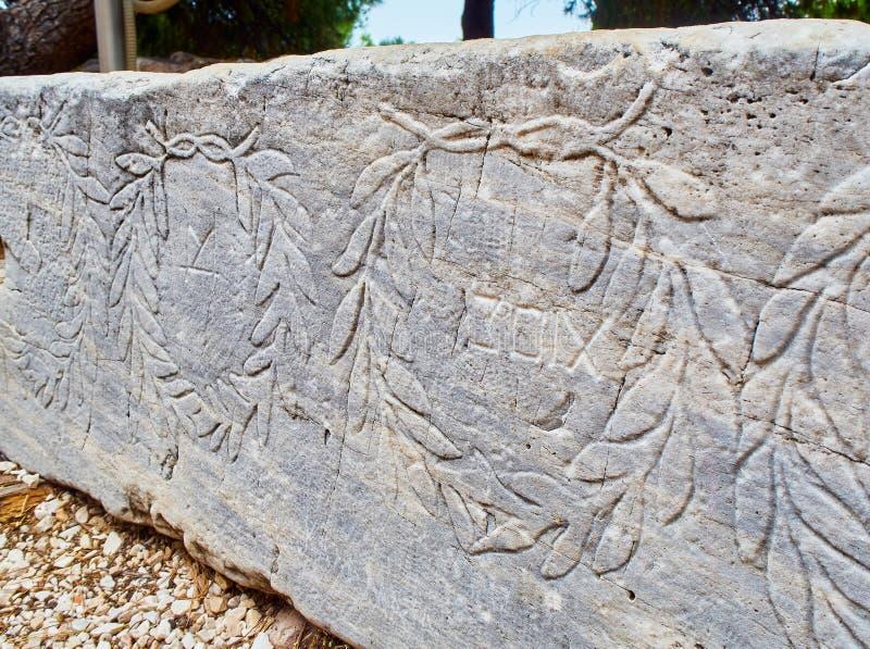 Uma chapa devotary que oferece ao godness de Apollo Acropolis atenas imagem de stock royalty free