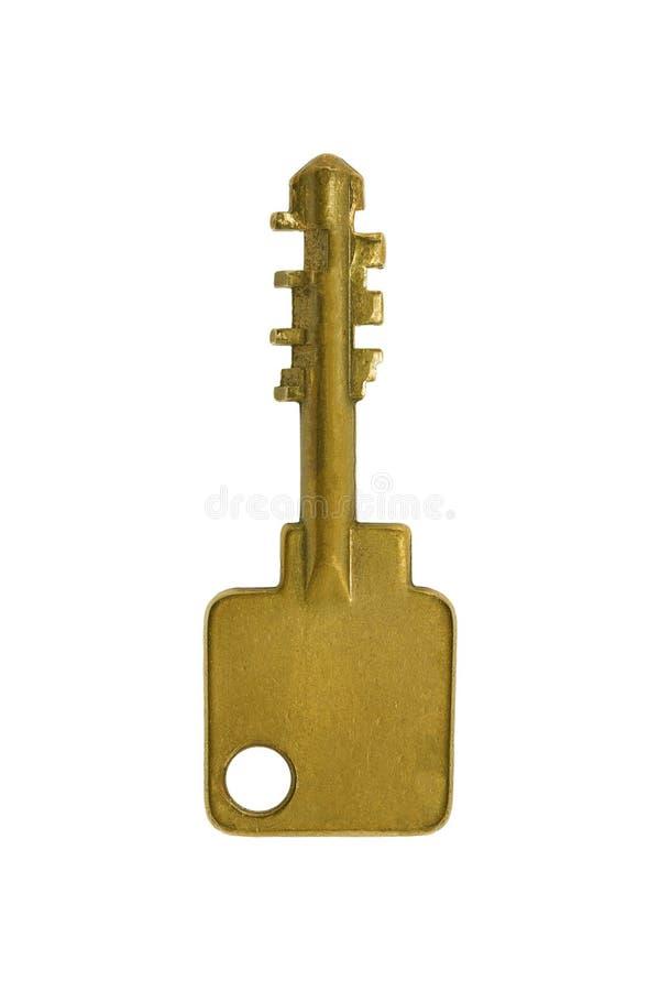 Uma chave dourada isolada no branco fotografia de stock royalty free