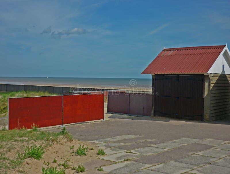Uma coleção de cabanas da praia, Sutton no mar fotografia de stock
