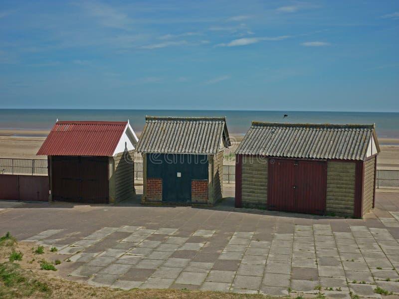 Uma coleção de cabanas da praia, Sutton no mar fotografia de stock royalty free
