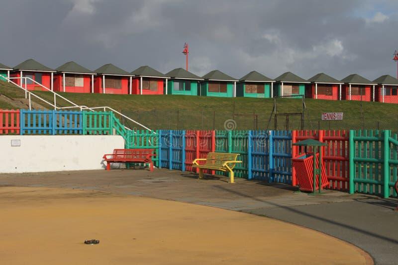 Uma coleção de cabanas da praia, Sutton no mar imagens de stock