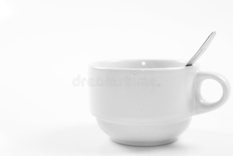 Uma colher da chávena de café e de café imagem de stock