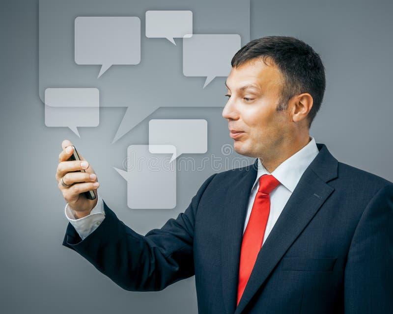 Uma comunicação do homem de negócio foto de stock