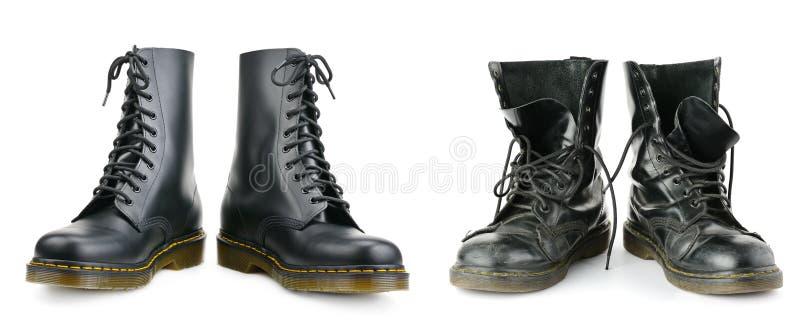 Uma e os mesmos pares de botas do ` s dos homens negros Novo e gastado imagem de stock