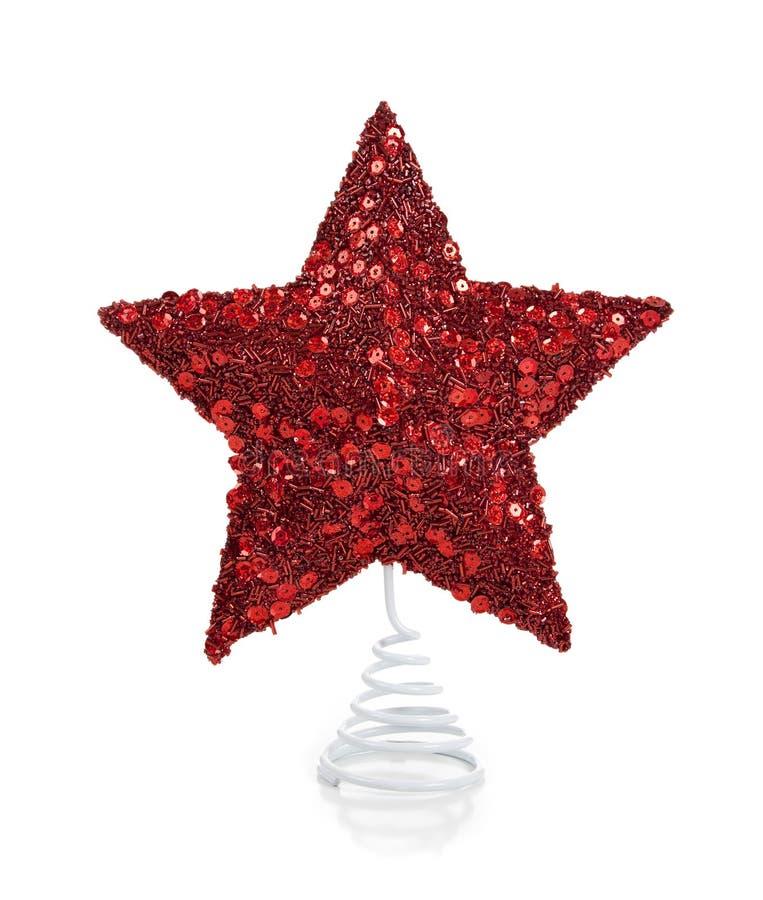 Uma estrela glittery vermelha do Natal no branco fotos de stock
