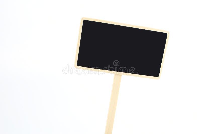 Uma etiqueta vazia do quadro-negro isolada em um fundo branco fotografia de stock