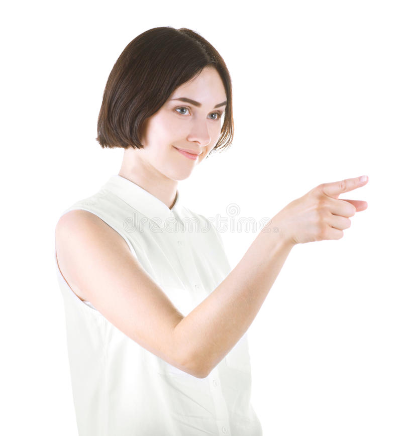 Uma fêmea profissional isolada em um fundo branco Apontar bonito da menina Senhora moreno bem sucedida na roupa ocasional foto de stock
