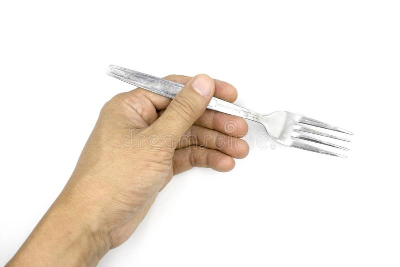 Uma forquilha masculina da terra arrendada da mão, mão do homem isolada no fundo branco fotos de stock