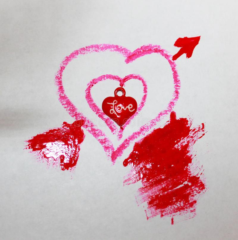 Uma foto de três corações pequenos no vermelho grande ilustração do vetor