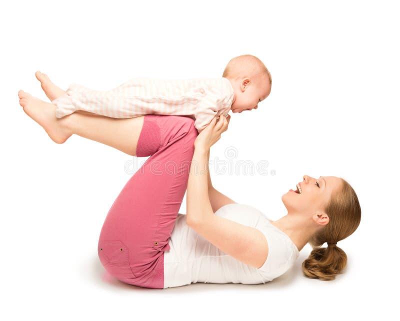 Ginástica da mãe e do bebê, exercícios da ioga isolados fotos de stock royalty free