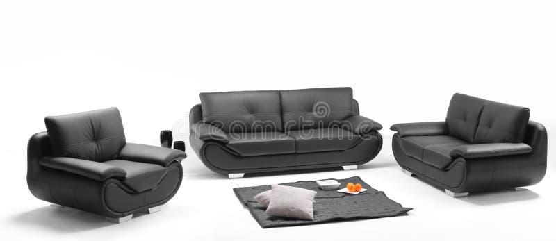 Uma ideia de um quarto com sofá de couro fotografia de stock royalty free