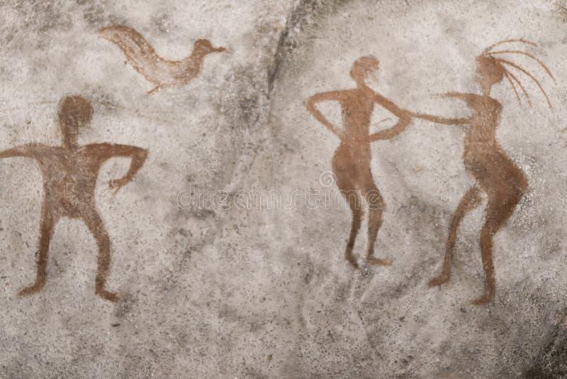 Uma imagem de um homem antigo, um pássaro na parede de uma caverna ilustração royalty free
