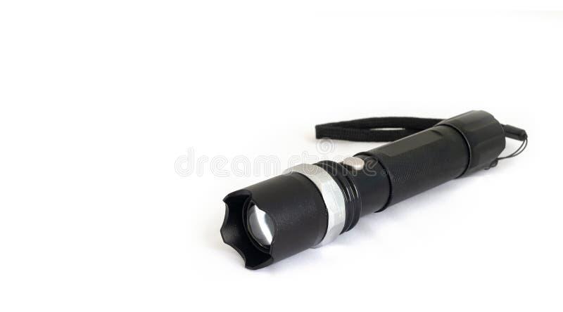 Uma lanterna elétrica isolada no fundo branco imagem de stock royalty free