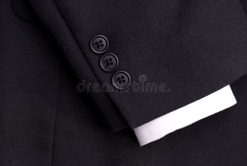 Uma luva do terno com um punho branco fotografia de stock royalty free