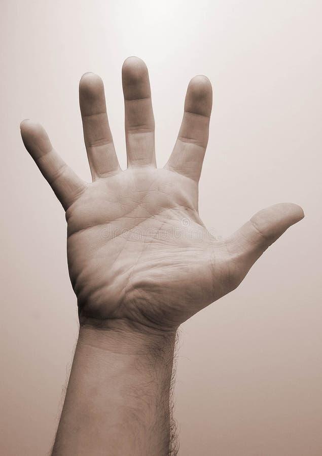 Uma mão imagem de stock