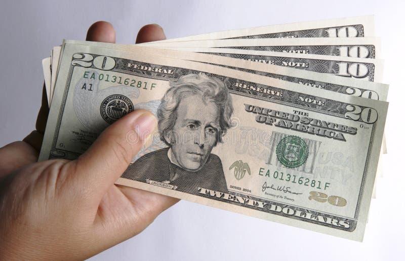 Uma mão com moeda dos E.U. foto de stock royalty free