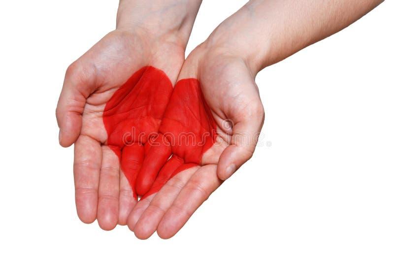 Uma mão com um coração foto de stock