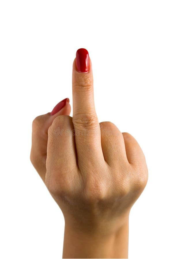 Uma mão fêmea com pregos vermelhos mostra o dedo médio foto de stock royalty free