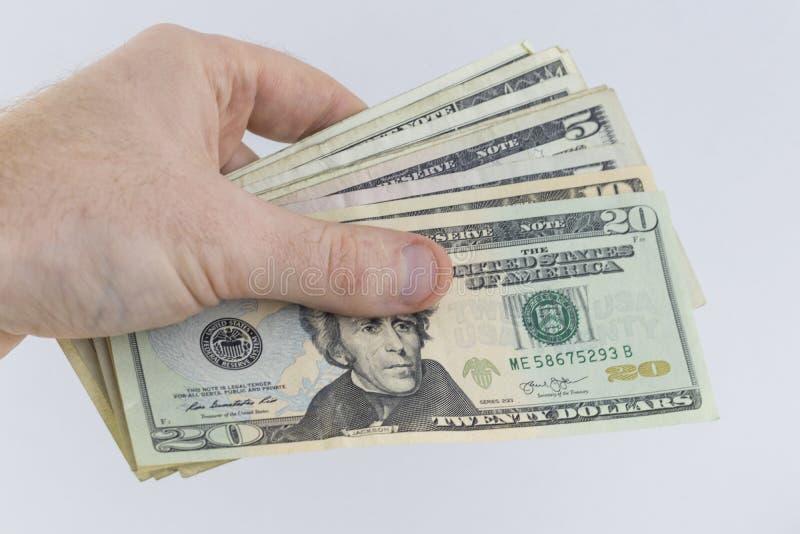 Uma mão que guarda o dinheiro americano fotos de stock royalty free