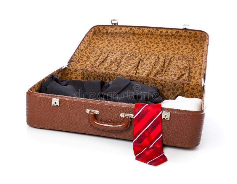Uma mala de viagem com roupa fotos de stock