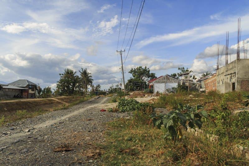 Uma manhã ensolarada no petobo da vila perdeu devido à liquefação imagens de stock