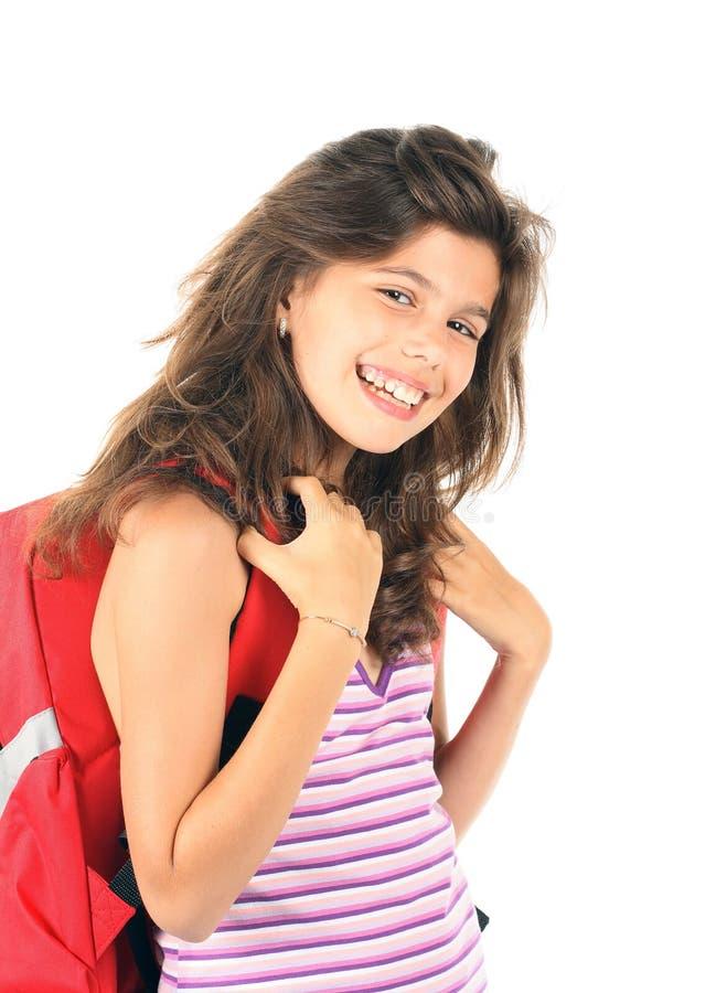 Uma menina bonita com trouxa imagem de stock royalty free