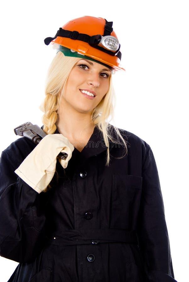 Uma menina bonita com uma chave do gás imagem de stock