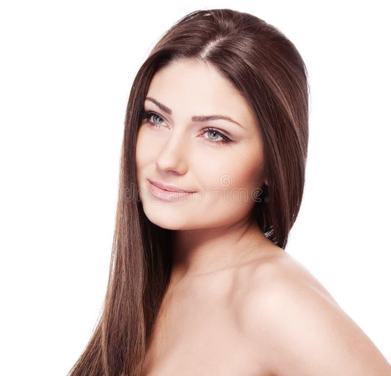 Uma menina da beleza no fundo branco foto de stock