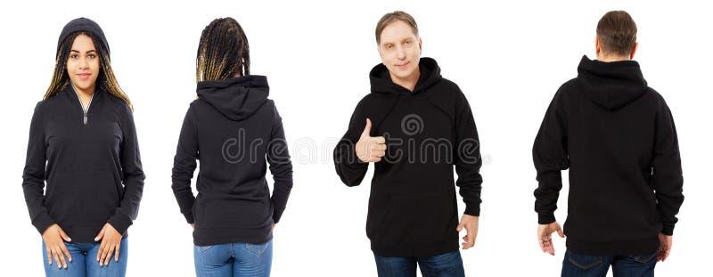 Uma menina em uma camiseta preta com uma capa e um homem em uma parte dianteira da camiseta e isolados para trás, modelo do hoodi imagens de stock royalty free