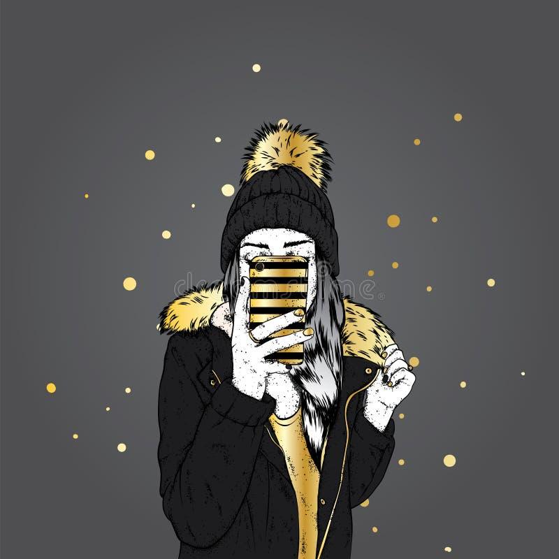 Uma menina para baixo em um revestimento à moda e em um chapéu bonito com um bubão macio Uma mulher está guardando um smartphone  ilustração royalty free