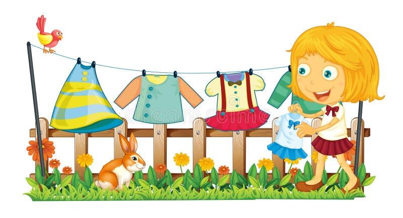 Uma menina que pendura a roupa no jardim ilustração royalty free