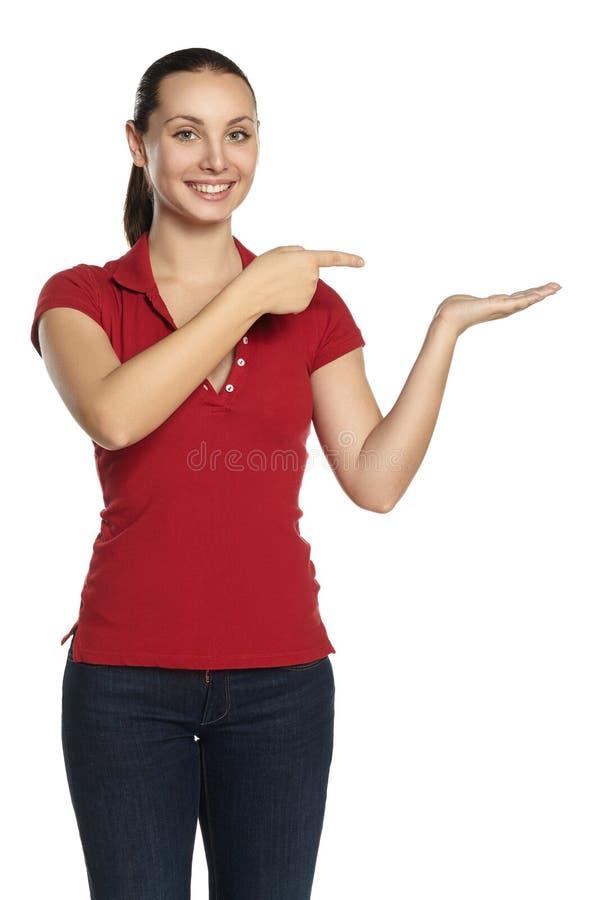 Uma moça mostra no assunto em sua mão fotografia de stock royalty free