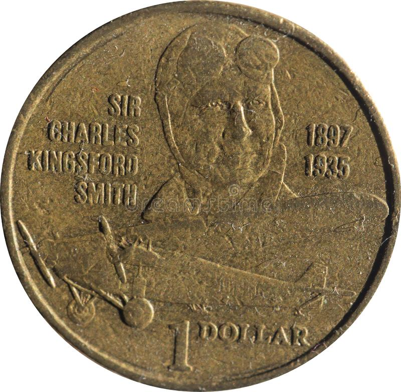 Uma moeda de cobre australiana do dólar que comemora o centenário do nascimento de Sir Charles Kingsford-Smith, pioneiro da aviaç fotografia de stock