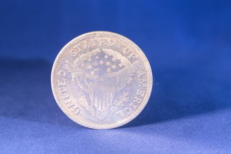 Uma moeda de prata do dólar imagens de stock