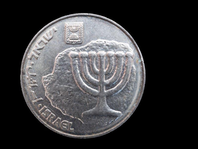 Uma moeda do shekel no fundo preto imagens de stock royalty free