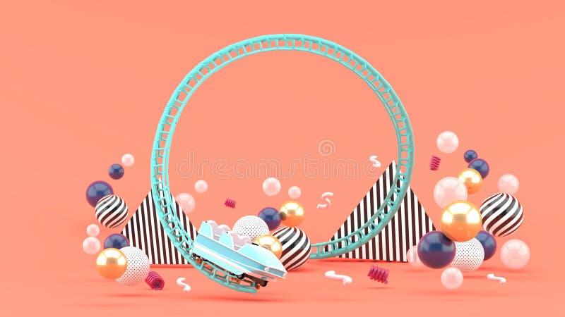 Uma montanha russa azul entre bolas coloridas em um fundo cor-de-rosa imagens de stock