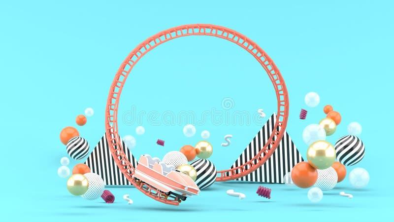 Uma montanha russa cor-de-rosa entre bolas coloridas em um fundo azul imagem de stock royalty free