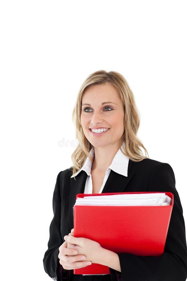 Uma mulher de negócios confiável que prende um arquivo vermelho fotos de stock royalty free