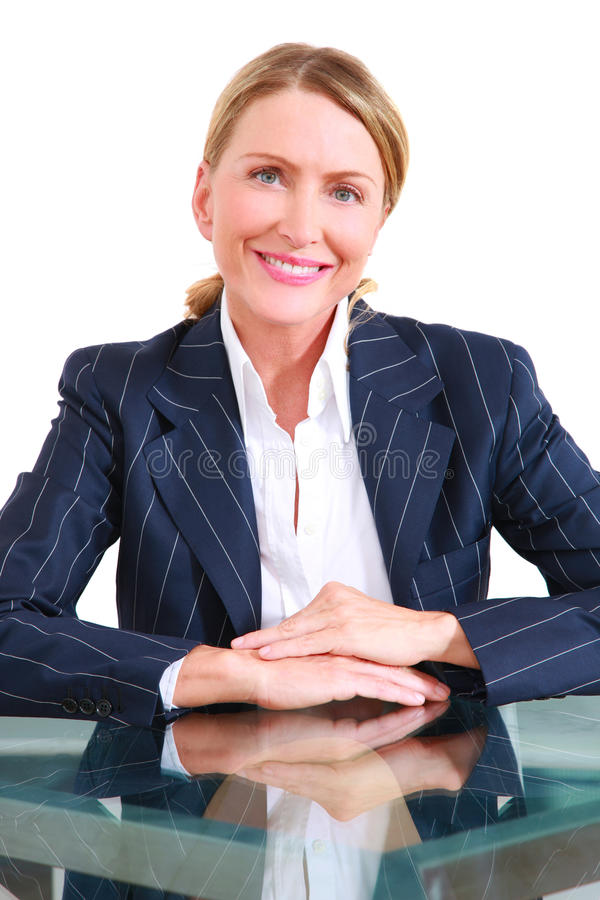 Uma mulher de negócios no escritório fotografia de stock royalty free